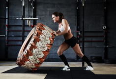 Training with tyre in gym Royalty Free Stock Image