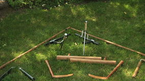 Training weapons in the grass. Martial arts training weapons for students stock video