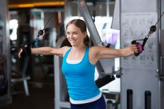 Training. Woman athlete training in the gym Stock Photo