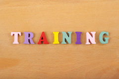 TRAINING word on wooden background composed from colorful abc alphabet block wooden letters, copy space for ad text Stock Photo