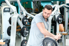 Training before work. Young and handsome businessman engaged in Stock Photo