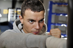 Training of young adult boxer in training suit Stock Photography
