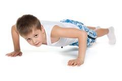Training young athletic boy Stock Photo