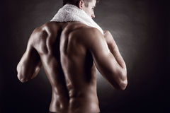 After training. Young man after training on dark background Royalty Free Stock Image