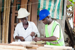 Training of young student in carpentry. Royalty Free Stock Images