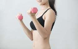 Trainings with dumbbells Stock Photography