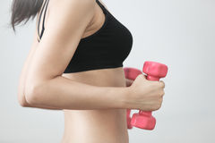 Trainings with dumbbells Stock Photo