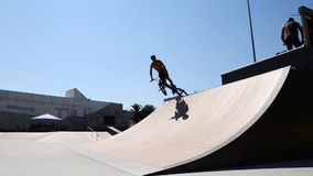 Trainings during the DVS BMX Series 2014 by Fuel TV. FELGUEIRAS, PORTUGAL - AUGUST 17, 2014: Trainings during the 1st Stage of the DVS BMX Series 2014 by Fuel TV stock footage