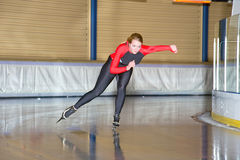 Trainings lap. Speed skater during a trainings lap on an indoor ice rink Royalty Free Stock Image