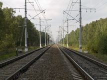 Trainrails to the horizon. Train rails moving off to the horizon Stock Image