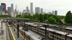 Trains Arriving and Leaving Chicago Loop District. Metra train network in Chicago Downtown stock footage