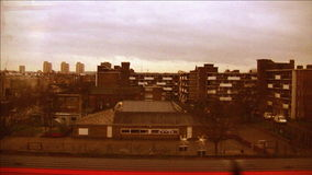 Trains and City (London, England). Riding the train out of London, England. View of the city. HD 1080 stock video footage