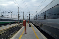 Trains coming and going. Express trains arriving and departing at Termini, the main railway station in Rome, Italy Stock Photo