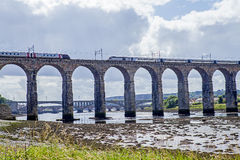 Trains crossing the Royal Border Bridge Royalty Free Stock Photography