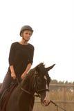 Trains d'équitation de fille Photographie stock
