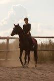Trains d'équitation de fille Image stock