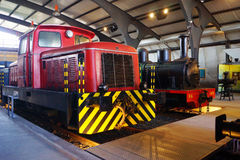 Trains d. Two locomotives painted of red colour, yellow colour and black colour Stock Photography
