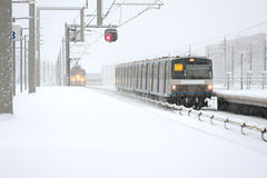 Trains driving in  snowy Amsterdam Netherlands Royalty Free Stock Photo