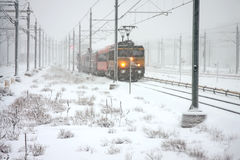 Trains driving in snowy Amsterdam Netherlands stock images