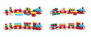 Trains en bois d'isolement pour les enfants heureux Photographie stock libre de droits