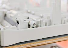 Trains en plastique d'imprimante désassemblée Image libre de droits