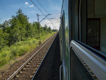 Trains going destination summer time. Other train coming from opposite railway stock images