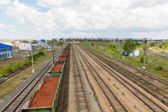Trains with goods and freight cars are on the railway. Trains with freight and freight cars are on the railway from above stock image