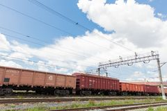 Trains with goods and freight cars are on the railway stock photo