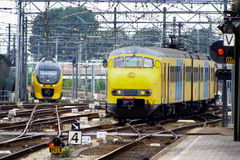 Trains, Hondekop and Sprinter, at Railwaystation Utrecht, Holland, the Netherlands. Two trains, type Hondekop and type Sprinter, rolling into Railwaystation Royalty Free Stock Photo