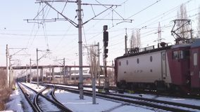 Trains intersecting. One passenger train leaving the railway station and the other arriving and intersecting at some point, with audio stock footage