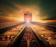 Trains on junction of railways track in trains station agains be Royalty Free Stock Photo