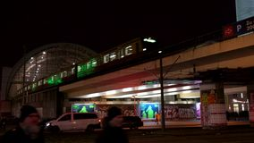 Tilt down from Television Tower at night to S-Bahn trains leaving and arriving, Alexanderplatz Station, Berlin, Germany. TRAINS LEAVING AND ARRIVING stock video