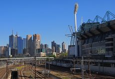 Trains leaving Melbourne. Trains leaving the Melbourne CBD passing the Melbourne Cricket Ground Stock Image