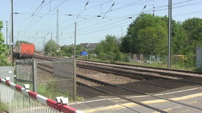 Trains at a main line level crossing. stock video footage