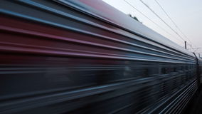 Trains meeting on high speed. Coming and passing opposition train on high speed in countryside stock footage
