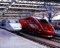 Trains in Midi Station, Brussels. TGV train of French Railways and Thayls 2 in the Brussels Midi Station, Brussels, Belgium, Western Europe Royalty Free Stock Image