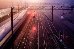 Trains with motion blur. Moving at night Stock Image