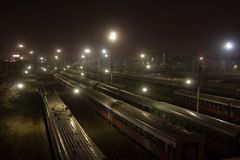 Trains at night city stock photos