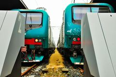 Trains parked in a station stock images