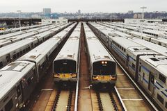 Trains Parked in the Terminal during Daytime Stock Photos