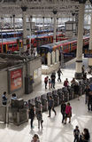 Trains and passengers at a London station Royalty Free Stock Image