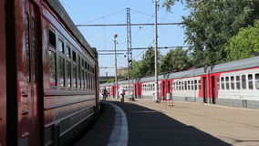 Trains and passengers at a Rizhsky Railway Station-- is one of the nine main railway stations in Moscow, Russia. Trains and passengers at a Rizhsky Railway stock footage