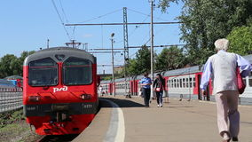 Trains and passengers at a Rizhsky Railway Station-- is one of the nine main railway stations in Moscow, Russia. Trains and passengers at a Rizhsky Railway stock video footage