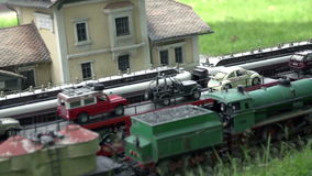 Trains passing by Maria Elend railway station in Austria stock video footage