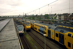 Trains passing near big city in Holland Stock Photos