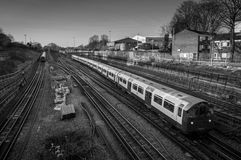 Trains passing on railroad tracks seen from above, London UK. Royalty Free Stock Image