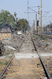 Trains passing through the slums in Titagarh, India. Trains passing through the slums where people live in difficult conditions in Titagarh, West Bengal, India Stock Images