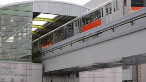 Trains are passing of TACHIKAWA-MINAMI Station in Tokyo, Japan. TOKYO, JAPAN - 22 AUGUST 2015 : Trains are passing of TACHIKAWA-MINAMI Station in Tokyo, Japan stock video footage