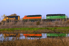 Trains reflecting in a lake Royalty Free Stock Images