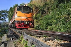 Trains running on death railways track crossing kwai river in ka Stock Image